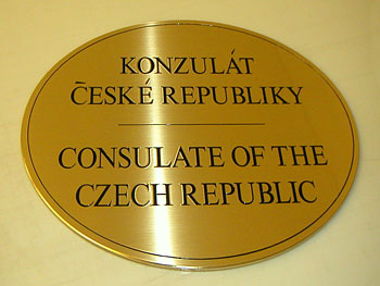 Brushed brass plaque with engraved graphics and paint infill
